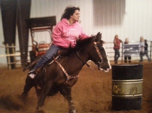 """Picture of me barrel racing with my main all around horse Commanche."""