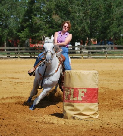 This is Chic. I only ran this mare for about a year and half (she had many soundness issues) I loved this mare and was just starting to clock in the 1D when I had to retire her. It broke my heart. A lot of hopes and dreams were lost when I had to quit running her. I love this pic of her. I was a little thinner in this pic. I can't fit in that shirt anymore!!